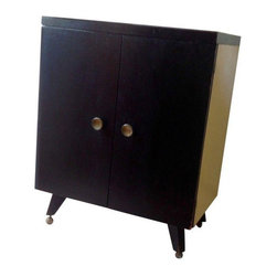 Pre-owned Mid-Century Modern Bar Cabinet Drinks Cart - Cool and understated chic on the outside with blond laminate and black doors full of secret promise, yet it opens up to a riot of atomic pink and black iconic 1950s style. The top folds open for easy access during cocktail time. Loaded with storage for glasses, bottles, ice bucket and a secret shelf and cubby hole. Condition is well loved but with years of life left. A few scuffs and dings, corrosion on the wheels (they don't roll so well anymore), handles are loose.