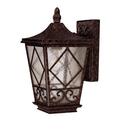 Savoy House - Felicity Wall Mount Lantern - A welcoming look for your porch or deck, this elegant lantern features wonderful textured elements of scrolls and glass. The eye-catching detail in the metal frame and mount takes on the gorgeous look of hammered stone.
