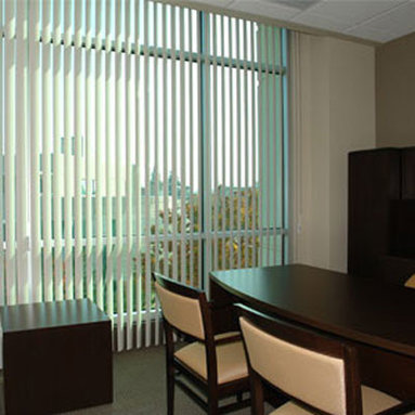 BlindSaver Basics Vinyl Vertical Blinds - Combine the classic style of vinyl verticals with the great pricing of BlindSaver! Available in a variety of colors and materials, our Basics Vinyl Vertical Blinds are a great choice for offices, and a favorite for large windows and patio doors.