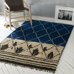 Nural Wool Rug - This fuzzy wool rug screams cozy. Pile it up in your favorite space or layer it over a larger jute rug. Either way, it's cozy.
