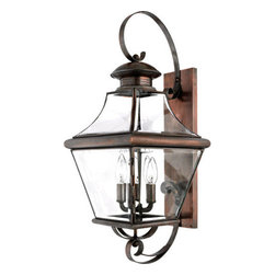Quoizel Lighting - Quoizel CAR8730AC Carleton 4 Light Outdoor Wall Light, Aged Copper - Long Description: The historical design of the Carleton outdoor fixture will bring a handsome colonial appeal to your home. The antique style solid copper, square tapered frame with a curved top eloquently displays the clear beveled glass, adding an elegant touch to the light.
