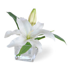 Winward Designs - Casablanca Lily White Flower Arrangement - With its long stalk and trumpet-shaped flower, the Casablanca lily wows. Whether this arrangement adorns a wedding, some other family celebration or a table in your home to celebrate all the comforts of home, its a great floral choice.