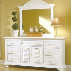 American Woodcrafters - Cottage Traditions Triple Dresser w Dressing - Arrange your bedroom toward a stylish outlook. 2 piece Cottage Traditions collection includes a versatile dresser with 2 door & 7 drawer storage - it's never been easier to stay organized. Plus, you'll receive a matching mirror with eggshell white finish and crested & louvered top. Cottage Traditions Collection. Set includes Triple dresser and matching dressing mirror. Triple dresser with 2 doors, 7 drawers and 1 adjustable shelf. Solid wood hardware of knobs in matching finish. Drawers feature conventional dovetailing. Veneer drawer bottoms. Center guided, metal-on-metal, plastic-on-plastic with positive action drawer stops to prevent drawers from being accidentally pulled from cases. Drawers are 14.5 in. front-to-back for ample storage. Corner blocks and cleats are glued and screwed in place. Each case has dust-proofing bottom for clothing protection. Mirror supports are shipped with the product. Beveled glass in mirrors. Signature louvered inserts. Eggshell White with fly-specking finish. Solid Pine, Pine veneer and MDF construction. 1-Year manufacturer's warranty. Triple dresser: 19 in. D x 70 in. W x 37 in. H (195.7 lbs.). Dressing mirror: 2.63 in. D x 44.38 in. W x 46 in. H (48.7 lbs.)