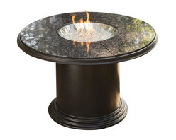 The Outdoor Greatroom - Grand Colonial Dining Height Gas Fire Pit Table - Truly a table for entertaining, the Grand Colonial dining height fire pit table is made from durable Supercast and has a matching removable burner cover. Both functional and beautiful, this magnificent fire pit table is built to last for years. This fire pit table comes with a matching cover for the round 20 inch stainless steel Crystal Fire Burner. Light up the night and add warmth to your outdoor space. These burners are made from high quality stainless steel and include tempered, tumbled glass, an LP hose and regulator, a metal flex hose, a gas valve, and a push button sparker. With just a push of a button, a beautiful clean-burning fire appears atop a bed of highly reflective Diamond glass fire gems. All burners are shipped with orifices for LP or NG fuels and are UL approved for safety and quality. Adjust the flame height to your desired setting and enjoy the magic and ambience of a warm glowing fire.