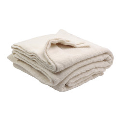 Sefte - Sefte Maya Boucle Cream Blanket - The cream Maya Boucle throw blanket is soft and warm with thick, plush boucle yarn, and accents modern decor with textural depth. Embodying a contemporary minimalism, Sefte designs are handmade by artisans with a focus on luxury and sustainability. Available in queen and king sizes; 90% Alpaca, 10% Polyamide; Sefte follows Fairtrade practices; Environmentally-friendly, oeko-tex standard dyes; Dry clean only
