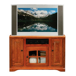 Eagle Industries - Oak Ridge 3 Doors Flat Screen TV Stand (Light Oak) - Finish: Light Oak. One glass panel door. Two raised panel doors. Two fixed wood shelves. Designed with decorative molding and fluted detailing. Warranty: Eagle's products are guaranteed against material defects for one year from date of delivery to the dealer. Made in USA. No assembly required. 45.5 in. W x 22 in. D x 29.25 in. H (99.7 lbs.)The Oak Ridge collection combines American oak hardwood with updated contemporary styling. Heavy crown molding, sleek lines, fluted side molding, black brushed metal hardware, solid oak frames and solid oak recessed doors give this transitional collection a style all its own