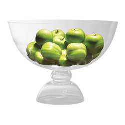 Grande Footed Bowl - Colorlessly transparent and dramatic in size, the Grande Footed Bowl cradles fresh fruit or decorative globes in a simple vessel of clear glass, elevating them on a hollow domed foot to give significance and style to your centerpiece arrangement. Much like a traditional trifle bowl in shape but sized for a crowd of hundreds, this dramatic dish is handsome and classic on a table.