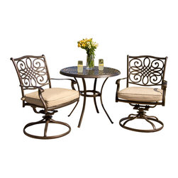 """Hanover - Traditions 3-Piece Dining Set (2 Alum. Cast Swivel Rockers, 32"""" Round Table) - The traditionally designed Hanover TRADITIONS3PCSW 3-piece patio set beautifully transforms any backyard into an elegant outdoor dining area with its superior quality and deep comfort feel. Included in this set are two deep cushioned swivel chairs and a 32"""" round table. Both the chairs and table have alumni cast frames featuring heavy gauge aluminum-alloy extrusions with uniquely supported inner walls. These frames will remain rust free for life. Even the champagne-colored cushions are built to last with a high grade of 100% polyester wrapped around polyurethane foam, ensuring deep comfort while maintaining its original full shape. The fabric of these pillows and cushions are also specifically designed, woven, and treated for quick drying while resisting stains and UV harm. This set is perfect for accentuating smaller patios and pool areas by saving space while providing optimum comfort. Traditions 3 Piece Outdoor Patio Set includes two outdoor swivel chairs and a round table."""