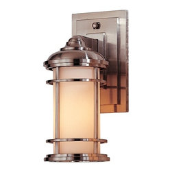 Feiss Lighting - 11-Inch Outdoor Wall Light - OL2200BS - This contemporary outdoor wall light was designed with the style of a lighthouse in mind. Mounted against the wall with a subtly stepped rectangular base, this sturdy fixture is constructed of die-cast zinc, with the bars of its shade's cage made of solid brass. Its glass is a lovely cream color, and the sleek brushed steel finish is a triple-plated and powder-coated lacquer for durability and weather resistance. Measures just under a foot in height, extends 6 inches from the wall. Backplate measures 7-1/2 inches high by 4-1/2 inches wide. Takes (1) 100-watt incandescent A19 bulb(s). Bulb(s) sold separately. Wet location rated.
