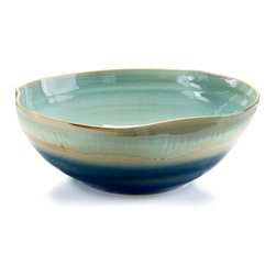 Shades of Nantucket Blue Bowl - Sumptuous yet unpretentious, art ceramics combine the principles of art with the appeal of earthy elements of design in your home. The Shades of Nantucket Blue Bowl, glazed in layers of turquoise, sand, and royal blue, brings this harmony of style points into your space with colors that have become immensely and enduringly beloved for beach houses and inland homes.
