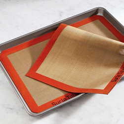 Sur La Table Silpat Baking Mat - If you don't have a Silpat and like to bake, you really should try one. Made out of food-grade silicon, they release the baked goods and wipe clean with a sponge — no stick, no mess, no problem. And the orange against the Cararra marble appeals to my design sensibility, too!