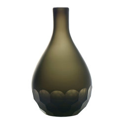 Concave Vase - This vase has curves in all the right places, which is a key design element in Finnish style. Fill it with simple, long-stemmed flowers for a modern look.