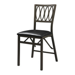 Linon - Linon Arista Ovals Folding Dining Chairs - Set of 2 Multicolor - LHD1299 - Shop for Dining Chairs from Hayneedle.com! Those surprise guests won't be a problem with the Linon Arista Ovals Folding Dining Chairs - Set of 2 ready to accommodate in an instant. These handsome chairs feature sturdy metal frames that fold out with ease and store away when needed. No skimping on comfort either the faux leather upholstery seats are perfectly padded. About Linon Home DecorLinon Home Decor Products has established a reputation in the market for providing the best trend-right products at the right price while offering excellent quality style and functional furnishings to every room in the home. Linon offers a broad selection of furnishings for today's discriminating and demanding retail environments. They offer outstanding values for every room; a total commitment of quality service and value that is unsurpassed in their industry. Care/MaintenanceThe beauty of furniture care is that it helps to protect your investment. Fine furniture is an important purchase. Proper care will help maintain your furniture's finish and ensure that it looks great year after year. Caring for furniture is easy. Following a few simple guidelines will help extend the life of your furniture. Always dust with a polish-moistened cloth. Polish cushions the cloth eliminating the scratching that occurs with dry dusting. Dust will scratch the furniture surface if not removed properly. Use a soft clean cloth that won't scratch the surface. Avoid coarse or scratchy materials or fabrics. Never use soap and water on furniture. Water can penetrate the finish and raise the grain on wood causing damage. Many common problems in furniture care are caused by the elements. If you are aware of these troublemakers the resulting damage can easily be avoided. Sunlight's ultraviolet rays can damage wood finishes. Arrange furniture out of direct sunlight; use sun-screening drapes during intense sunlight hours; and rot
