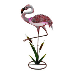 Zeckos - Pink Flamingo Statue with Colored Glass Insert Metal Sculpture - This pink flamingo walks amongst the cattails, and promises not to fly away, instead will proudly take up residence in your home, garden or shop Crafted from metal, this fun sculpture is hand-painted with enamel paints in tranquil tropical hues sure to delight and features a colored glass insert body. Measuring 26 inches (66 cm) high, 13 inches (33 cm) long and 5.75 inches (15 cm) wide, this metal flamingo statue will accent your entryway, the windowsill at the office or your bed of blooms. Wherever you choose to display it, this flamingo sculpture is sure to receive rave reviews