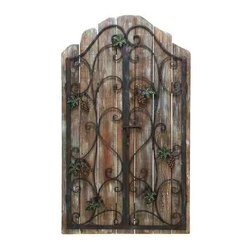 UMA - Grapevine Wall Grille - A wrought iron style wall grille with an arched top is decorated with grape clusters and vines with a weathered wood backdrop