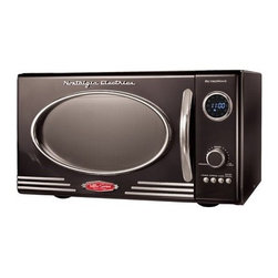 """Nostalgia Electrics - Retro Series 0.9 CF Microwave Oven in Black - Microwave in style with this unique and sleek retro-styled microwave oven from Nostalgia Electrics. Its oval window and chrome accents may have a classic look, but its 12 pre-programmed features, handy dial control, turntable and 800 Watts of cooking power offer every modern convenience. With a 0.9 cubic foot interior cavity, this unit is sized for everyday use. At home in any kitchen and great for a rec room or theater room. Another great item from the Nostalgia Electrics Retro Series family of products. Features: -Microwave oven. -Color: Black. -0.9 cubic foot capacity. -Unique sleek, retro styling with chrome accents. -Dial controls feature 12 pre-programmed settings for a variety of different foods. -LED display with digital clock. Specifications: -Interior dimensions: 12.5"""" H x 8"""" W x 11.5"""" D. -Exterior dimensions: 19"""" H x 11"""" W x 14"""" D."""