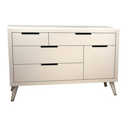 Tulip Juvenile - Tulip Juvenile | Søren Double Dresser - Made in Canada by Tulip Juvenile. The nostalgic and timeless appeal of the Søren Double Dresser makes it a perfect storage piece for the modern nursery or child's room. The mid-century legs give the piece a playful feeling, while the five drawers are child-safe and provide ample storage space. Meeting the toughest child-safety and environmental standards, the Søren Double Dresser creates a safe and elegant nursery. Product Features:  GREENGUARD GOLD Certified to be low in VOCs for a safe and healthy nursery Meet all USA and Canadian safety standards 100% Solid Oak Metal finished sabots (decorative caps on feet) Slow-Motion, self-closing, anti-pinch drawer glides with safety locks - lifetime warranty Recessed encase back panel reinforces structure Dust cover on furniture bottom eliminates dust entry Six-inch deep Drawers, with English dovetail for increased strength