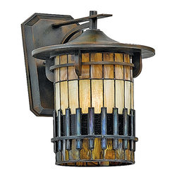 Frontgate - Reflections Outdoor Wall Lantern - Handcrafted geometric art glass shade with 80 to 144 pieces, depending on the size of the fixture. Includes an incandescent bulb or a Title 24-compliant energy-efficient 13-watt or 18-watt compact fluorescent bulb. CFL spring self-ballasted GU 24. Photo-electric eye turns light on from dusk to dawn. Professional installation recommended. The warmth and detailed elegance of arts-and-crafts artistry shines through in our Reflections Outdoor Lighting collection. Each handmade shade features 80 to 144 pieces of earth-toned art glass, set in cast iron with a rich Bergamo finish.  .  .  .  .  . Post not included . Imported.