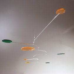 Mobile 86 - The circular discs are made of transparent acrylic glass, a type of plastic that looks like glass but does not break.