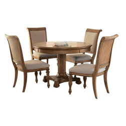 American Drew - American Drew Grand Isle 6-Piece Round Dining Room Set in Amber - The Grand Isle collection is a lifestyle bedroom and dining room group that offers high end, yet casual up to date tropical style with multiple options for any room of the home; creating a collection that is perfect for many homes, vacation homes or even smaller size vacation condos. The amber finish has a warm overtone with subtle dark burnished accents that make the natural soft distressing show through. Design elements used in Grand Isle include carved and shaped pilasters, woven drawer fronts and a louver motif; all adding a higher end look to the collection. This collection is sure to add a relaxed, yet sophisticated style to most homes and offers plenty of options to help with storage and organization.