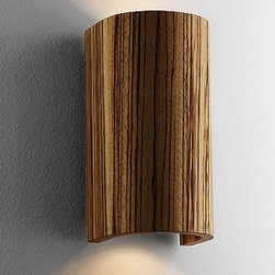 """Domus - Tube wall sconce - Product Description   The Tubewall sconcefrom Domus has been designed by Mario Vivaldi.This wall mountedluminaire is great for incandescent or energy saving halogenlighting. The Tube is composed of premium wood available in your choice of a walnut-oiled or zebrano finish. This fixture is available in a small or large size. Large sizeonly uses energy efficient halogen bulb. DOMUS lamps are developed in a teamwork approach. Designers, wood experts, design engineers, and lighting designers create products to serve their users.All are working to create high quality, long-lived products from the very best of raw materials. Each individual lamp is hand-made and subsequently subjected to stringent quality controls.  Details:                                Manufacturer:               Domus                                  Designer:                             Mario Vivaldi                                                Made in:              Germany                                  Dimensions:                             Small: H: 6.9"""" (17.5 cm)X B: 3.5"""" (9 cm) X A: 3.1"""" (8 cm)              Large: H: 7.9"""" (20.0 cm)X B: 3.5"""" (9 cm) X A: 3.1"""" (8 cm)                                                              Light bulb:                             Small: 2 X 35Wincandescent              Large: 2 X 11Whalogen                                                              Material               Premium wood"""