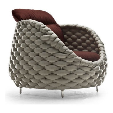 Eco Friendly Furnture and Lighting - Plush and comfortable, thick hand-coiled upholstered foam curves over a steel frame. Seat and back cushions are covered in smooth wool to carry the overall softness through the design from aesthetics to comfort.