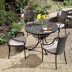 Home Styles - Home Styles Stone Harbor Mosaic Outdoor Dining Set Multicolor - 5601-3080 - Shop for Tables and Chairs Sets from Hayneedle.com! Not only does the Home Styles Stone Harbor Mosaic Outdoor Dining Set create a welcoming al fresco dining space it also ensures your outdoor furniture stands out from the rest with its unique look and exquisite beauty. With its timeless charm and upscale appeal this set which includes a mosaic dining table and choice of four Cambria Laguna or Newport dining chairs makes a great addition not only to your al fresco dining area but to your sunroom or indoor dining space as well. Constructed of small square slate tiles in a naturally occurring gray variation the beautiful round dining table is large enough for four place settings. It also has an umbrella hole that will support a standard patio umbrella for some much-needed shade on particularly hot days. If you prefer a little sunshine on your shoulders the umbrella hole can be closed with the included black cap for a continuous surface. Made from black-finished powder-coated steel the gracefully curved cabriole-style legs are as sturdy as they are elegant. Featuring a two-tone walnut-brown all-weather resin wicker seat and back over a sturdy black-finished steel frame Laguna and Newport dining chairs exude contemporary elegance and upscale appeal to beautifully offset the table's more timeless charm. Cambria dining chairs feature sturdy black-finished steel frames with cross-motif backs and tie-attachment Taupe cushions for unmatched comfort. All the chairs stack for convenient off-season storage. Adjustable nylon glides on the table and all chair options prevent damage to your floor and provide stability on uneven surfaces. The perfect choice for any one who wants lasting function without sacrificing on style the Stone Harbor Mosaic Outdoor Dining Set is sure to be the highlight of any setting. Additional Information: Dining table dimensions: 39.5 diam. x 30H inches Laguna dining chair dimensions (each): 23.25W x 22.25D x 36H inches Newport dining chair dimensions (each): 24.5W x 24.25D x 36H inches Cambria dining chair dimensions (each): 23.25W x 22.25D x 36H inches Comfortably seats 4 people Table features umbrella hole that will support a standard patio umbrella Chairs stack for convenient storage Easy assembly required Please Note: We recommend storing or at the very least covering mosaic table tops in areas that experience freezing conditions. If left outdoors the grout can absorb water which will expand when it freezes leading to cracks. About Home StylesHome Styles is a manufacturer and distributor of RTA (ready to assemble) furniture perfectly suited to today's lifestyles. Blending attractive design with modern functionality their furniture collections span many styles from timeless traditional to cutting-edge contemporary. The great difference between Home Styles and many other RTA furniture manufacturers is that Home Styles pieces feature hardwood construction and quality hardware that stand up to years of use. When shopping for convenient durable items for the home look to Home Styles. You'll appreciate the value.
