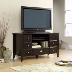 "Sauder - Shoal Creek 53"" TV Stand - With country roots and contemporary soul, Shoal Creek's inviting, casual appearance offers a stylish alternative to the traditional home office. The warm espresso finish is accented with soft nickel-finish bin-style drawer pulls in a distinctive updated shape. Tapered legs and sculpted drawer and door edges confirm this design's country origin. The warm, casual appearance hides a heart built for technology. Each piece is designed with appropriate cable management and correctly dimensioned with storage for everything from files to media. Features: -Holds TVs weighing 70 lbs or less; base must be no larger than 53 1/8 inches.-Adjustable center shelf holds audio/video equipment.-Hidden storage areas behind doors with faux drawer fronts feature and adjustable shelf.-Drawer with metal runners and safety tops.-Jamocha Engineered Wood finish.-Shoal Creek collection.-Recommended TV Type: Flat.-TV Size Accommodated: 53"".-Finish: Jamocha Wood.-Powder Coated Finish: No.-Gloss Finish: No.-Material: Engineered wood.-Solid Wood Construction: No.-Distressed: No.-Exterior Shelves: Yes.-Drawers: Yes -Number of Drawers: 1.-Drawer Glide Material: Metal runners.-Soft Close Drawer Glides: Yes.-Safety Stop: Yes.-Ball Bearing Glides: Yes.-Joinery Type: T-lock.-Drawer Dividers: No.-Drawer Handle Design: Knobs and Pulls..-Cabinets: Yes -Number of Cabinets: 2.-Number of Doors: 2.-Door Attachment Detail: Hinges.-Interchangeable Panels: No.-Magnetic Door Catches: Yes.-Cabinet Handle Design: Knobs and finger pulls.-Number of Interior Shelves: 4.-Adjustable Interior Shelves: Yes..-Scratch Resistant: No.-Removable Back Panel: No.-Hardware Finish: Brushed silver.-Casters: No.-Accommodates Fireplace: No.-Lighted: No.-Media Player Storage: Yes.-Media Storage: Yes.-Cable Management: Cable hole.-Remote Control Included: No.-Weight Capacity: 70 lbs.-Swatch Available: Yes.-Commercial Use: No.-Collection: Shoal Creek.-Eco-Friendly: Yes.-Recycled Content: No.-Lift Mechanism: No.-Expandable: No.-TV Swivel Base: No.-Integrated Flat Screen Mount: No.-Non-Toxic: Yes.-Product Care: Wipe with a damp cloth.-Country of Manufacture: United States.Specifications: -ISTA 3A Certified: Yes.-CARB 2 Certified: Yes.-CARB Certified: Yes.-FSC Certified: Yes.-General Conformity Certified: Yes.-EPP Certified: Yes.Dimensions: -Overall Height - Top to Bottom: 28.937"".-Overall Width - Side to Side: 53.15"".-Overall Depth - Front to Back: 19.449"".-Drawer: Yes.-Shelving: Yes.-Cabinet: Yes.-Legs: Yes.-Overall Product Weight: 118 lbs.Assembly: -Quick and easy assembly with patented T-lock drawer system.-Assembly Required: Yes.-Tools Needed: Phillips screwdriver and hammer.-Additional Parts Required: No.Warranty: -Product Warranty: 5 Years."