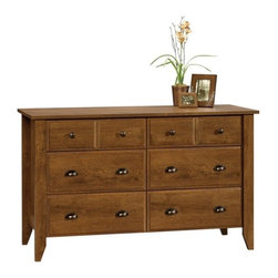 Sauder - Shoal Creek 6 Drawer Dresser in Oiled Oak Fin - 6 Drawers. Feature patented T-lock assembly system. 4 Lower drawers are extra deep. Drawers with metal runners and safety stops. Made of engineered wood. Assembly required. 55 in. W x 18 in. D x 33 in. H