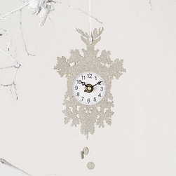 Cuckoo Clock Ornament - Christmas time is now! I think cuckoo clocks are so nostalgic, and one faced with glitter and meant for the tree earns double points in my book. This silvery clock should have a spot on every wish list this season.
