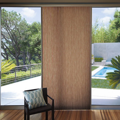 Vertical Window Treatments - Hunter Douglas Vertiglide honeycomb shade allows you to draw the shade left, right or center.