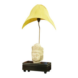 China Furniture and Arts - Stone Buddha Lamp with Shade - Viewing this work of art, one could say that the lamp is an added bonus to the stone head statue of Buddha. The silk shade is made in the particular yellow color of the temple. Solid black wooden base unites the whole piece that brings the quality of museum display to your home. Max 75-watt. (Bulb not included)