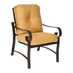 Woodard - Woodard Belden Cushion Dining Chair - The Belden aluminum outdoor patio furniture collection completes the trio of Belden offerings from Woodard. As usual no apologies are necessary for this stunning collection of 24 items. Sharing its hand formed cast aluminum styling heritage with the Belden sling and Belden padded sling collection the Belden cushion collection is considered by some to be the pinnacle of Woodard's outdoor patio furniture products. Woodard's skilled artisans have outdone themselves in creating designer-class frame detail that soothes the eye while providing strength and durability.The Belden cushion aluminum outdoor patio furniture collection includes all the outdoor living outdoor patio furniture and dining furnishing options that you are considering for your home your retreat at the shore or your mountain chalet. The rust-resistant powder coated frame finishes can take whatever weather Mother Nature is in the mood to share and the cushions trims and chair ties are available in a wealth of attractive standard and designer fabric grades in solids stripes textures and patterns.The name Woodard Furniture has been synonymous with fine outdoor and patio furniture since the 1930s continuing the company�s furniture craftsmanship dating back over 140 years. Woodard began producing hand-made wrought iron furniture which led the company into cast and tubular aluminum furniture production over the years.� Most recently Woodard patio furniture launched its entry into the all-weather wicker furniture market with All Seasons which is expertly crafted and woven using synthetic wicker supported by an aluminum frame.� The company is widely known for durable beautiful designs that provide attractive and comfortable outdoor living environments.� Its hand-crafted technique used to create the intricate design patterns on its wrought iron furniture have been handed down from generation to generation -- a hallmark of quality unmatched in the furniture industry