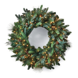 Frontgate - Majestic Pre-lit Christmas Wreath - Standard Garland drapes beautifully across the mantel and over doors or windows. Flexible garland wraps around columns, weaves through posts, and makes a splendid table runner. Double-sided Garland has more greenery tips for fullness at any angle. Traditional greenery is pre-lit with clear, warm, superbright lights that shine for 3,000 hours. Prelit Centerpiece includes 3 LED candles (excluding batteries). Full and thick, our impressive Majestic Wreaths and Garlands brims with lifelike cedar, sweeping longleaf pine, Douglas fir, Scotch pine, berries, and genuine pinecones. Our four unique garlands, including a cordless version, help you decorate like a pro indoors and outside.  .  .  .  . . Christmas Classic glows with Red, Green, and Frost lights . Peppermint features Red and Frost lights . 6 ft. cords . To maximize fullness, greenery will need to be shaped.