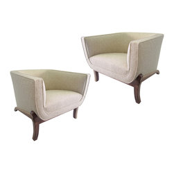 Seating - This pair of barrel chairs in the style of the 1960s feature an elegant faceted shape enhanced by skillfully applied piping. Perhaps the most compelling parts of the design are the modified cabriole legs which splay slightly in the front while the elongated back legs arc gracefully across the side echoing the shape of the chair they support.