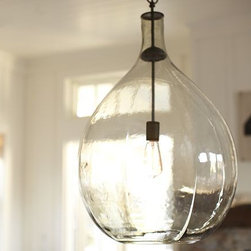 Clift Glass Pendant - I love the look of glass demijohns but prefer to leave my floors and surfaces clutter free. This lamp is perfect because I get my demijohn and light fixture all in one.