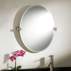 """24"""" Helsinki Oval Tilting Mirror - Contrasting the oval shape of its beveled glass, the 24"""" Helsinki Oval Tilting Mirror features rectangular, solid brass brackets that blend with a modern decor."""