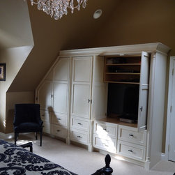 French Country Master Bedroom  Renovation - Custom Designed wardrobe and Media cabinet in an Antiqued cream finish.