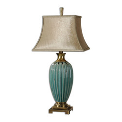 Uttermost - Angelica Blue Table Lamp - This gorgeous blue table lamp is a nod to Tuscan-inspired glamor. From the beautiful, distressed crackle finish to the coffee bronze neck and base, this ceramic lamp will add Old World character to your traditional or transitional living room or bedroom.