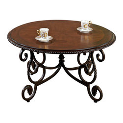 Steve Silver Furniture - Steve Silver Crowley Cocktail Table - Bring the unique look of Inch Old World Inch style into your home with the elegant Crowley Cocktail Table. This table adds the rustic, rich look of timeless Spanish and Mediterranean style to your decor. Pieces of the Crowley collection are heavily detailed with carved accents scalloped edges. The curved base supports a beautiful inlayed table top.