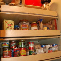 Glide-Out Pantry Shelves - Organize your canned goods and surplus food efficiently with pull out pantry shelves custom made to fit your existing cabinets and closets by ShelfGenie of Kentucky.