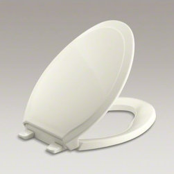 KOHLER - KOHLER Grip-Tight Rutledge(R) Q3 elongated toilet seat - The subtle styling of the Rutledge toilet seat makes it a versatile design choice for elongated toilets. Made from stain-resistant plastic, the seat includes Grip-Tight bumpers to help hold it in place and prevent shifting. This Q3 Advantage seat features