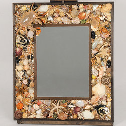 Large Mirror With Seashell Surround by MJ Skipper Art - This mirror will cost you a pretty penny, but isn't it absolutely gorgeous? I can't even imagine how many shells are in the frame!