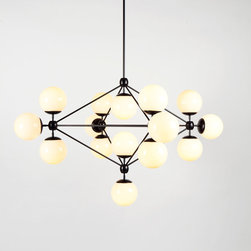 Modo Chandelier - 4 Sided, 15 Globes - Black/Cream - The Modo series was inspired by off-the-shelf parts like those found at inexpensive lighting stores. Unlike off-the-shelf parts, however, Modo is painstakingly engineered and custom CNC-milled from solid aluminum. The spoke-and-hub system allows for dozens of configurations, making Modo as versatile as it is beautiful. By Jason Miller for Roll & Hill. Photo credit: Joseph de Leo