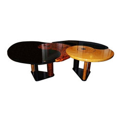 """Pre-owned Memphis Style Nautilus Dining Table - These high design, Memphis-style tables are individually supported by three cylindrical columns which terminate in a triangular base. The tables were designed to work in tandem, nesting comfortably together to form a large dining table or desk. The nautilus themed tops feature an imaginative patterns complimented by the black lacquer that surrounds them.     The darker table is 65"""" long and 55"""" wide, while the lighter one is 63"""" long and 53"""" wide; both are 30"""" high."""