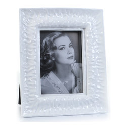 "Concepts Life - Concepts Life Photo Frame  Perpetual Tide  5x7"" - Reminiscent of the ocean and channeling its calming power, our Perpetual Tide frame infuses calm energy into your photographs and brings sophistication to your home. This white frame with a glossy finish makes a graceful addition to any photo frame collection.  Modern home accent Contemporary white picture frame Beautiful and elegant home accent Rectangular photo frame Made of polyresin Textured glossy finish Easel back for horizontal or vertical display Various sizes available Holds 5 x 7 in. size photo Dimensions: 9""w x 11""h x 1""d Weight: 3 lbs"