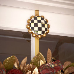 """MacKenzie-Childs - Courtly Check Wreath Hanger - MacKenzie-ChildsCourtly Check Wreath HangerDetailsMade of polyresin and metal.Because each piece is hand painted no two are exactly alike.12""""L x 3""""W.Imported.Designer About MacKenzie-Childs:Established in 1983 MacKenzie-Childs combines vibrant colors and patterns to create a whimsical collection of tableware furniture and decorative accessories that epitomize """"tradition with a twist."""" The company's designers draw inspiration from the pastoral setting of their studios located on a 65-acre former dairy farm in Aurora New York."""