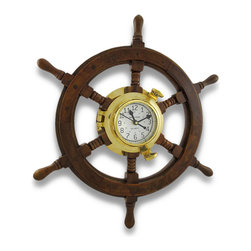 Zeckos - Nautical Oak Ships Wheel Brass Porthole Wall Clock 18 in. - This maritime wall clock is the perfect accent to any nautically themed room with its ship's wheel design and is sure to earn a coveted spot on your walls. It measures 18 inches in diameter (46 cm) and 2 1/2 inches deep (6 cm), with the brass clock in the center measuring 3 3/4 inches in diameter (10 cm) and features bold easy to read numbers in both 12 hour and 24 hour format. The clock face has an antique look to it and features the words 'Ship's Time' in the center with black minute, hour and second hands. The clock also features quartz movement and runs on just 1 AA battery (not included). To change the battery or adjust the time, slightly loosen the brass fittings, and since it's hinged, simply open the clock like a book. It easily hangs on the wall using a single nail or screw via the keyhole hanger on the back. It's crafted from beautiful oak wood, and would make a great housewarming gift for both friends and family.
