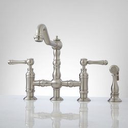 Delilah Deck-Mount Bridge Faucet with Side Spray - Lever Handles - This luxurious bridge faucet features an elegant hook spout, a sculpted body and shapely lever handles. Made of solid brass with matching side spray.