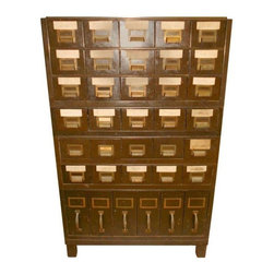Pre-owned Vintage Industrial Steel File Cabinet - This vintage industrial steel file cabinet has brass pulls and original name plates. Thirty drawers pull out for card filing while six larger drawers on the bottom row hold file folders. An industrial-strength piece that runs more toward Army olive green than the photo depicts.